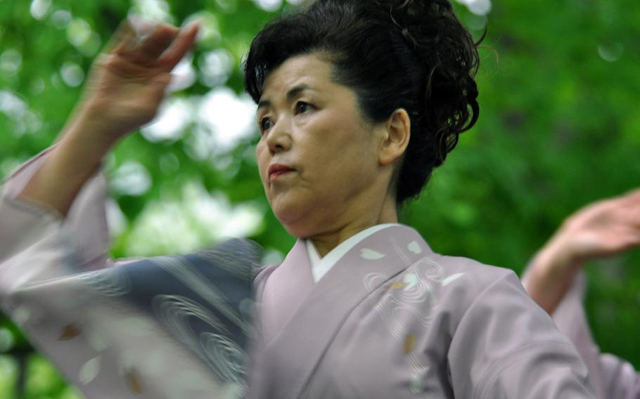 A woman from Shingo, Japan, dances around what local villagers call the Tomb of Christ, during a festival in late May.