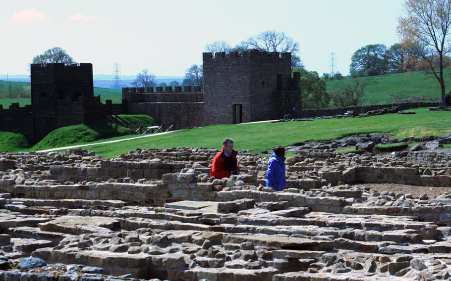 Visitors walk among the ruins at Vindolanda, one of the forts associated with Hadrian's Wall. The fort gives visitors an opportunity to talk with on-site archaeologists and guided tours are available on weekends.