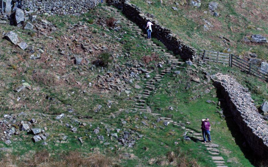 Hadrian's Wall has its hiking challenges, such as this steep climb. The wall connects England's east and west coasts, rambling through quiet pastures, rocky crags and rugged moorland.