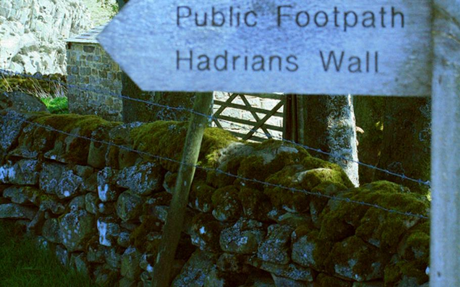 Signs such as these guide hikers walking the Hadrian's Wall Path National Trail.