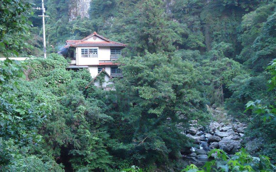 The Kan Art Museum sits on the mountainside about halfway up the mountain to the falls. The former traditional Japanese hotel, now in disrepair, features the works of storied Japanese artist Kozaki Kan.