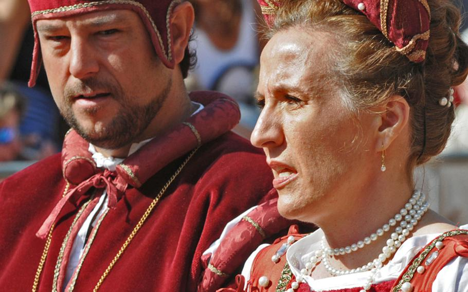 The lord and lady of Niola, Italy's Ciassa district, attend the festivities in fine attire. In real life, they are Massimo Debenedetti, a car company manager, and his wife.