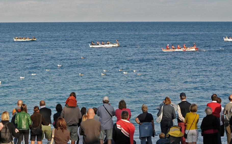 Local residents and tourists watch the traditional Regata Storica at Noli in September 2010.