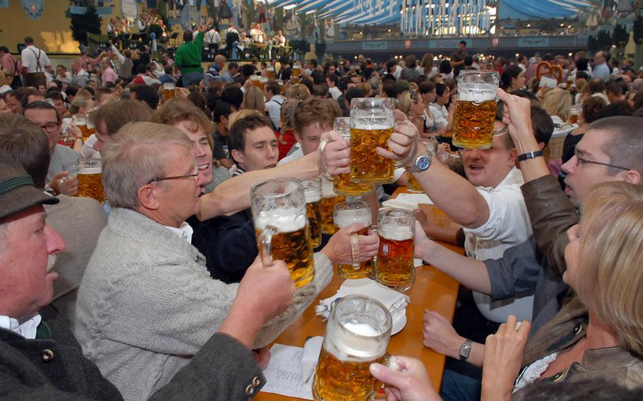 Revelers at a previous Oktoberfest in Munichraise a toast minutes after the first keg was tapped at noon. Most of the huge beer tents are overflowing before the festival even gets under way.