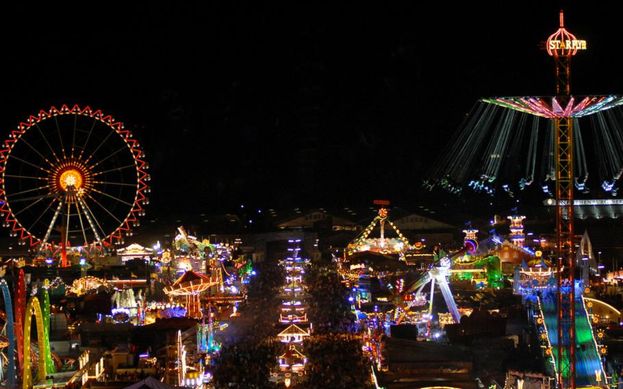 The festival grounds with carnival lights make for a pretty nighttime view at Oktoberfest.
