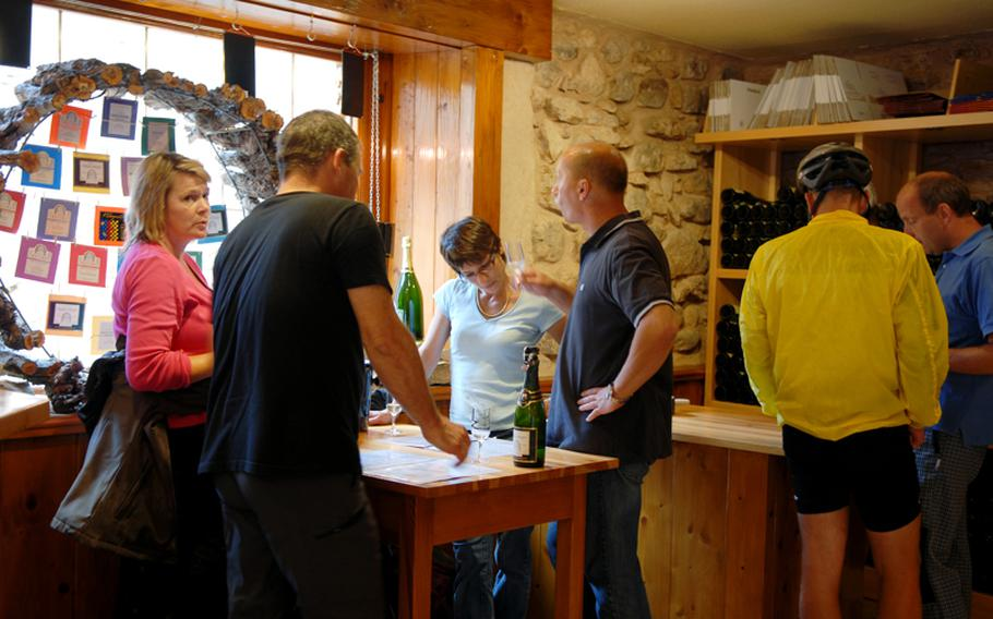 Customers taste before they buy their wines at wholesale prices.