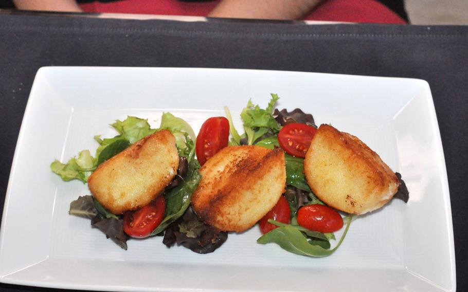 This might look like potatoes, but  it's actually fried buffalo mozzarella cheese with tomatoes and greens. It was one of a handful of appetizers offered during a recent visit to Vineria.