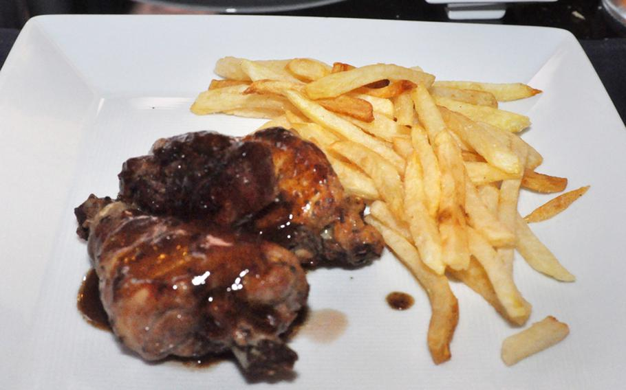 Not all the food offered at Vineria is unusual to American palates. This second-course offering featured chicken with a variation of barbecue sauce and french fries.