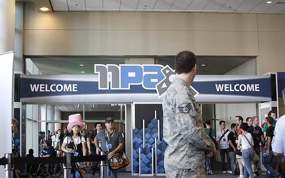 Staff Sgt. Alan Servello, 30, mans the Air Force Reserve recruiting booth at PAX. Servello and Terpening said they had talked to a handful of interested gamers.