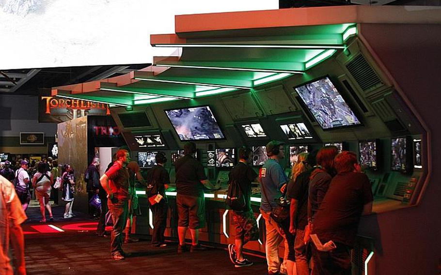 The exhibition hall was decked out with E3-style game booths, some more creatively lit than others.