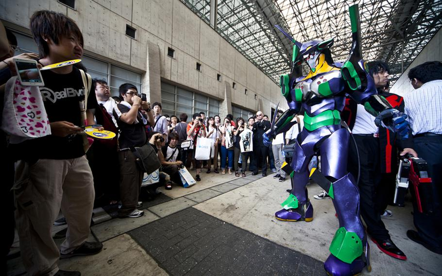 There were many cosplayers dressed in elaborate costumes  Saturday at the Tokyo Game Show 2011 held at Chiba Prefecture's Makuhari Messe convention center.
