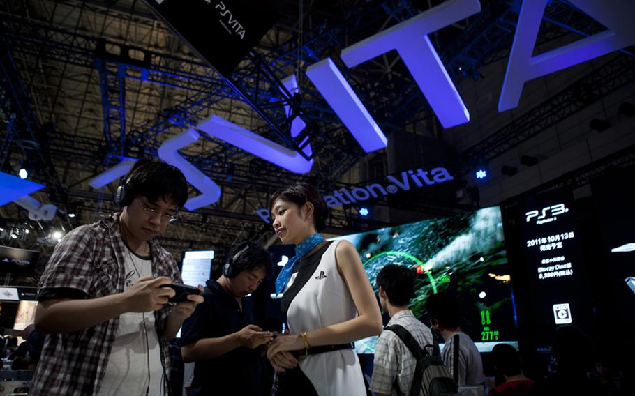 Many waited in long lines to try out Sony's new PlayStation Vita Saturday at the Tokyo Game Show 2011.
