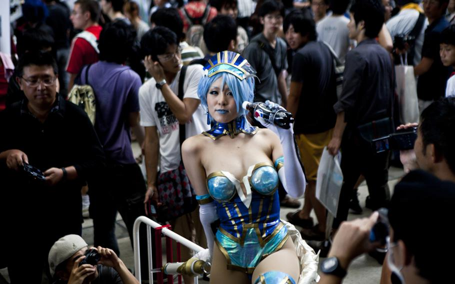 """Although the games were the top draw, there were plenty of side attractions, including the scantly clad """"cosplayers"""" who provided a side attraction at Saturday's Tokyo Game Show 2011 at Chiba Prefecture's Makuhari Messe convention center."""