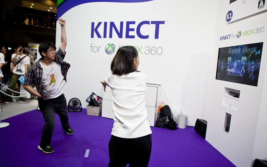 """A gamer tries out his moves on the Microsoft Kinect version of """"Michael Jackson: The Experience HD,"""" Saturday at the Tokyo Game Show 2011 held at Chiba Prefecture's Makuhari Messe convention center."""