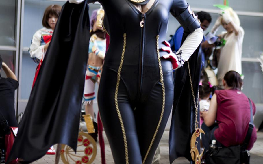 A cosplayer dressed as the popular video game vixen Bayonetta was one of the many elaborately dressed, Saturday at this year's Tokyo Game Show.
