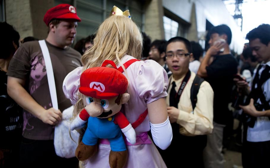 Elaborately dressed cosplayers attracted attention at the Tokyo Game Show.