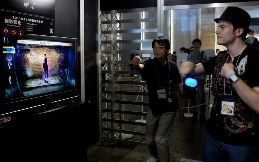"""A gamer tries out his moves on the PlayStation Move version of """"Michael Jackson: The Experience HD,"""" Saturday at the Tokyo Game Show 2011 held at Chiba Prefecture's Makuhari Messe convention center."""
