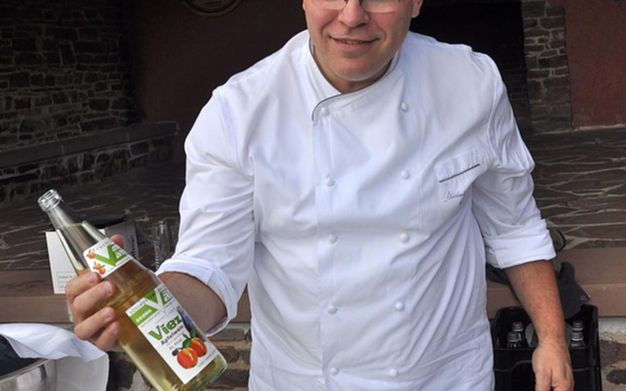 Michael Buchna, an employee at a hotel near the Saarschleife, prepares some Saarland specialties, including Apfelwein, a tart cider made from green apples. Buchna was preparing the lunch for a group of foreign officials visiting on a recent Friday.