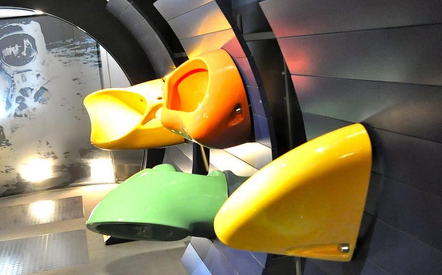 Several brightly colored and oddly shaped urinals  at the Villeroy &  Boch museum. Villeroy & Boch still does big business in bathroom fixtures. A showroom in the complex allows guests to ogle the company's latest offerings, which include high-tech urinals, swimming-pool-size hot tubs and kitchen tiles with tiny, color-changing LED lights.