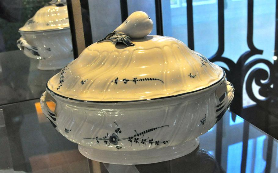 The museum's earliest pieces, including this original by Pierre Joseph Boch, whose porcelain cookery from 1770 features an indigo-and-white flower pattern still used by the company today.