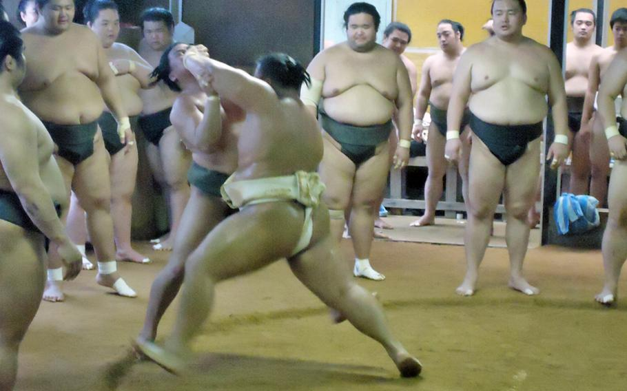 The art of sumo wrestling is part tradition and part brute force. Here, one sumo wrestler from the Sadogatake sumo stable in Fukuoka uses a shot to the face of another to get him out of the ring.