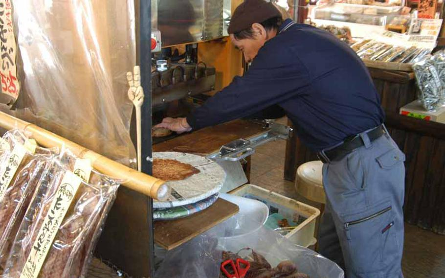 A Japanese artisan presses fish into a crunchy snack in Obama, Japan, a small seaside town at the base of the active volcano that shares the name with the 44th president of the United States.