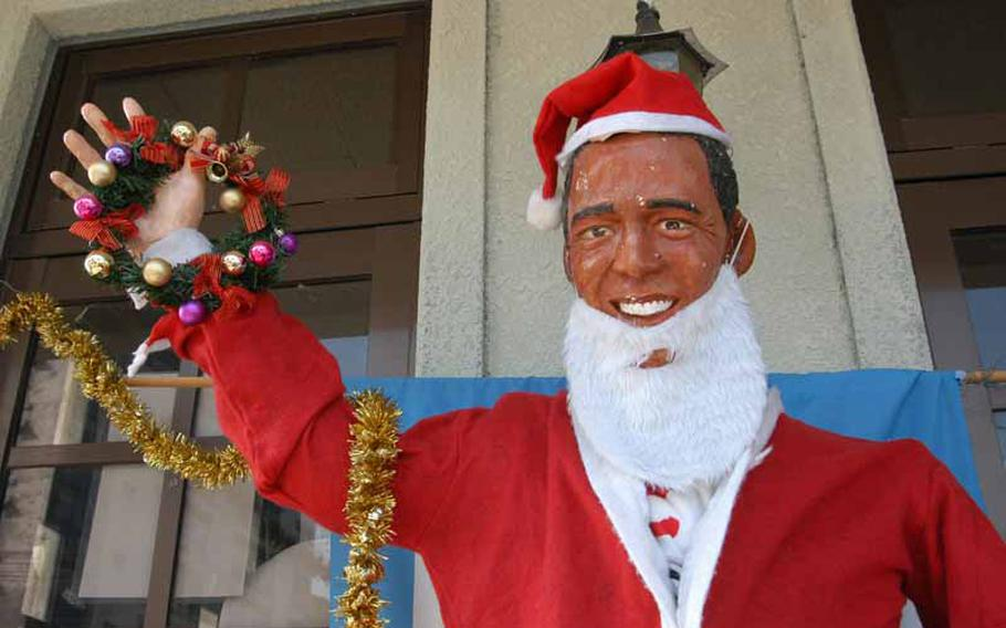 Dressed for the holidays, a life-size statue of President Barack Obama greets visitors to the tourist information center in Obama, Japan. The small town should not be confused with its bigger sister city up north, and sits at the base of the active volcano, Mount Unzen.
