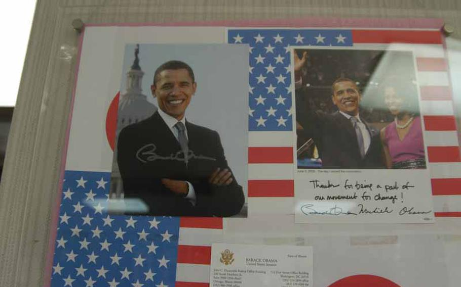 An autographed photo of the U.S. president, Barack Obama, and other souvenirs, hang in the tourist information center in Obama, Japan.