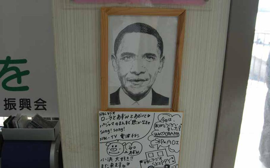 A portrait of President Barack Obama hangs in the tourist information center in Obama, Japan.