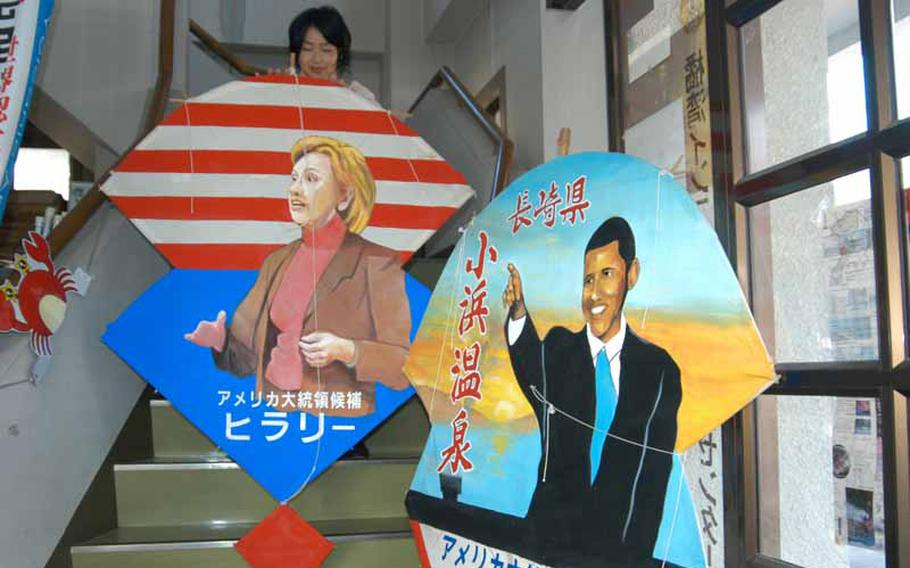 Kites depicting President Barack Obama and Secretary of State Hillary Rodham Clinton sit in the tourist information center in Obama, Japan.