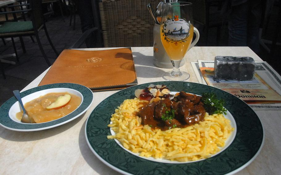 One of the more popular wintertime favorites at Zum Domstein in Trier, Germany, is a hearty serving of venison. The venison is served with a juniper sauce, spaetzle and stewed apples.