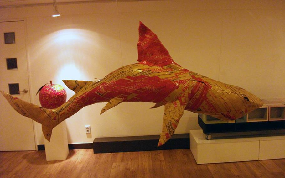 A shark hangs from the ceiling of the Jong IE Nara Paper Art Museum in Seoul.