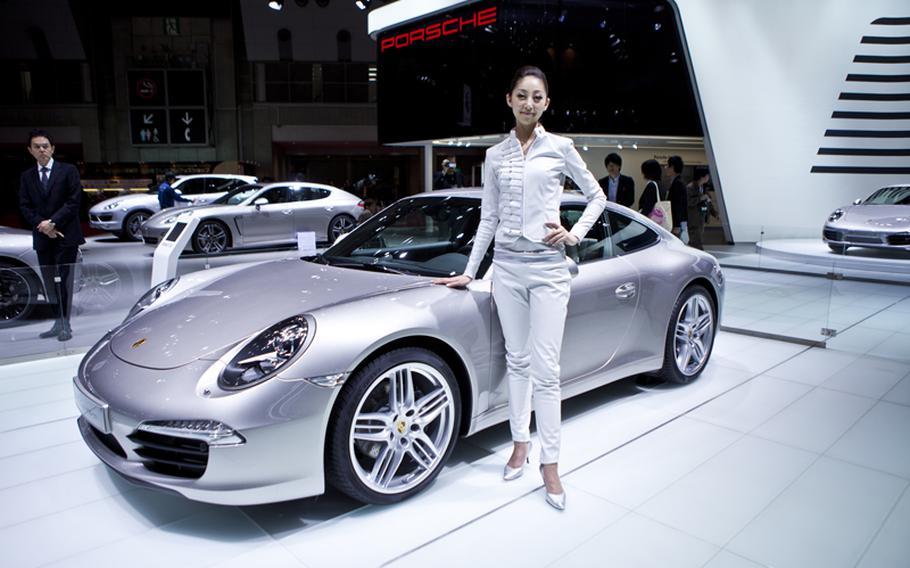 A woman models Porsche's new 911 Carrera S.