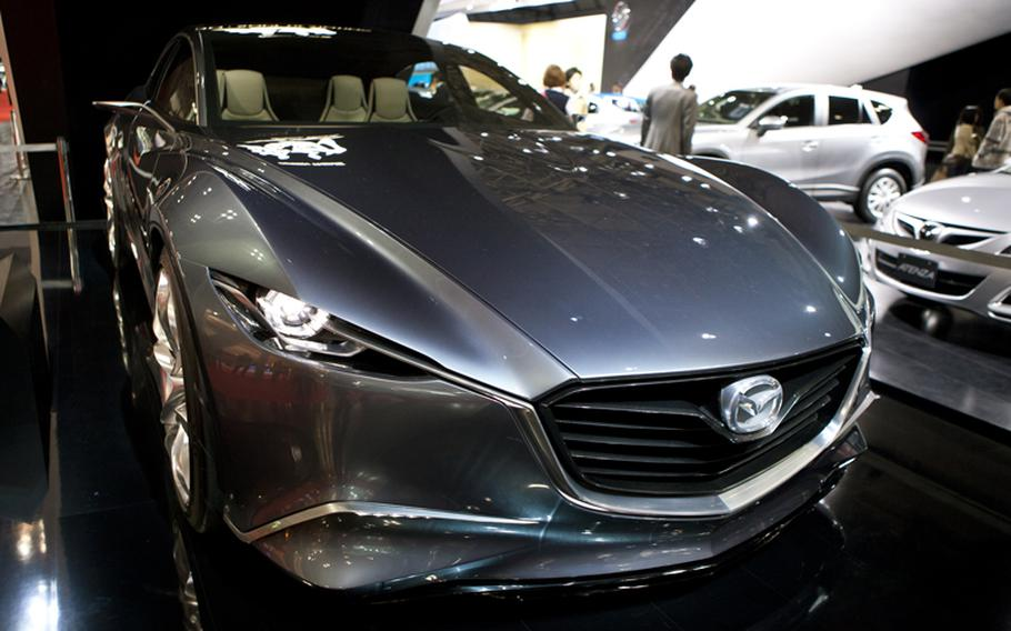 """This shiny Mazda Kodo is one of many cars on display. The theme for the event is """"Mobility can change the world."""""""