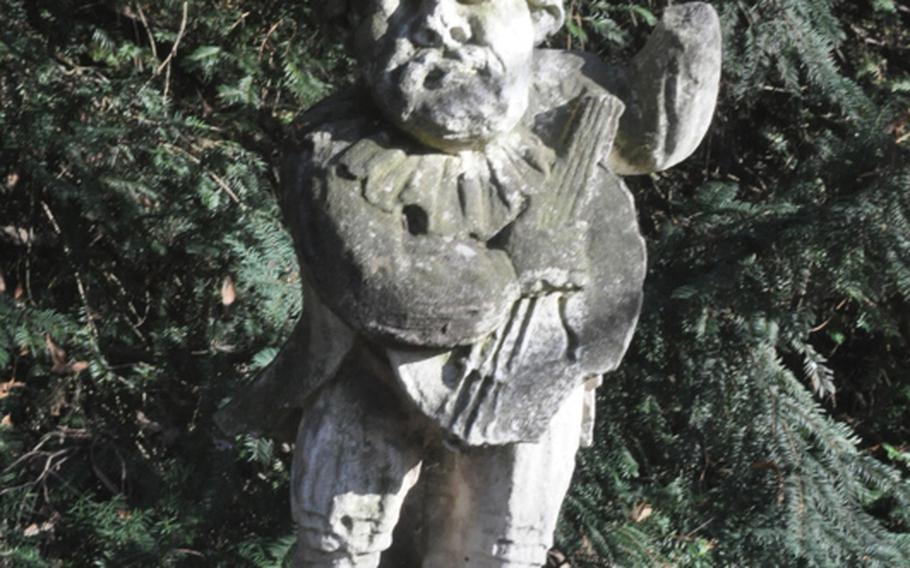 This sculpture of a minstrel sits near the entrance to the labyrinth at the Villa Pisani Nazionale complex in the town of Stra, Italy. There are hundreds of statues in the gardens.