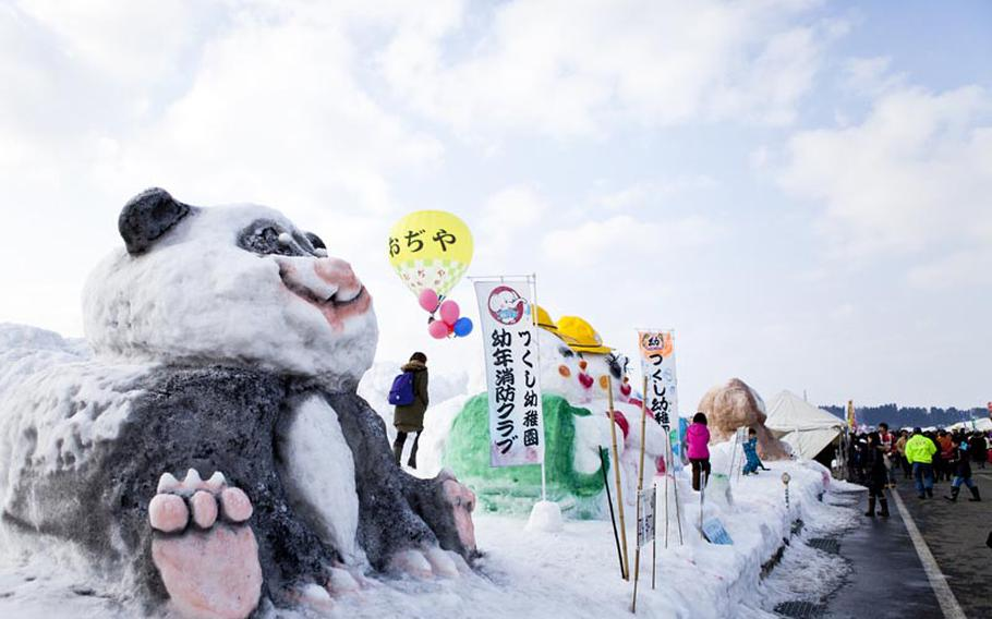 Local organizations build colorful snow sculptures that are on display all weekend at the annual hot air balloon festival in Ojiya, Japan.