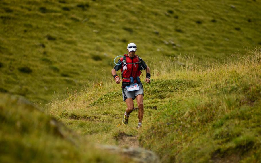 A competitor in the 71-mile race through the Mont Blanc massif hits his stride after descending one of the five peaks that the racers had to climb during the race.