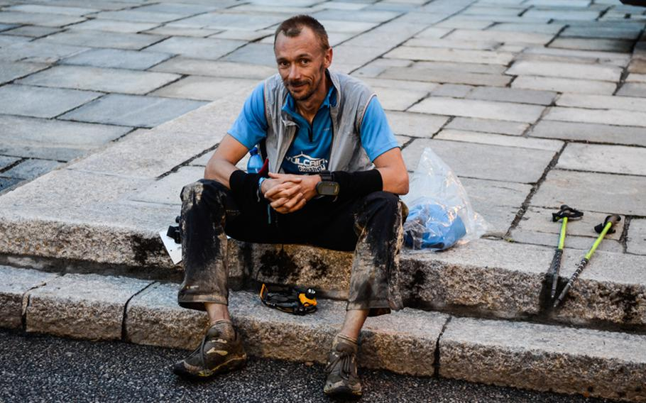 The UTMB TDS race started at 7 a.m. in Courmayeur, Italy, on Aug. 29 and ended in Chamonix, France. Only 43.2 percent of the racers completed the ultramarathon this year, one of whom is seen resting here.
