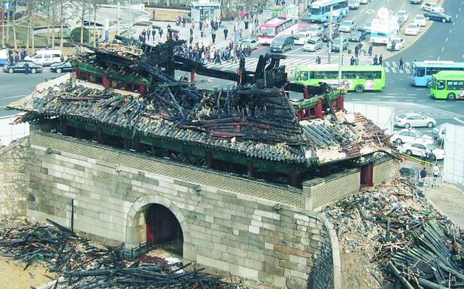 An aerial view of the charred remains of Seou's Namdaemun Gate following a fire in February 2008.