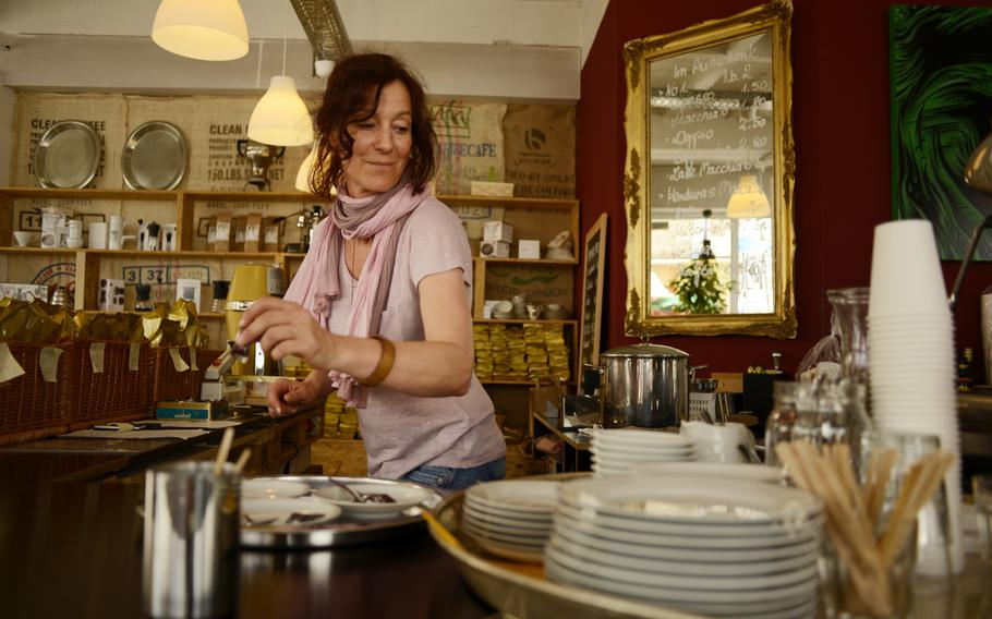 Stephanie Bebensee works behind the counter at Kaffeerösterei Kaiserslautern. Bebensee and her husband, Christian Bebensee, opened the store in October.