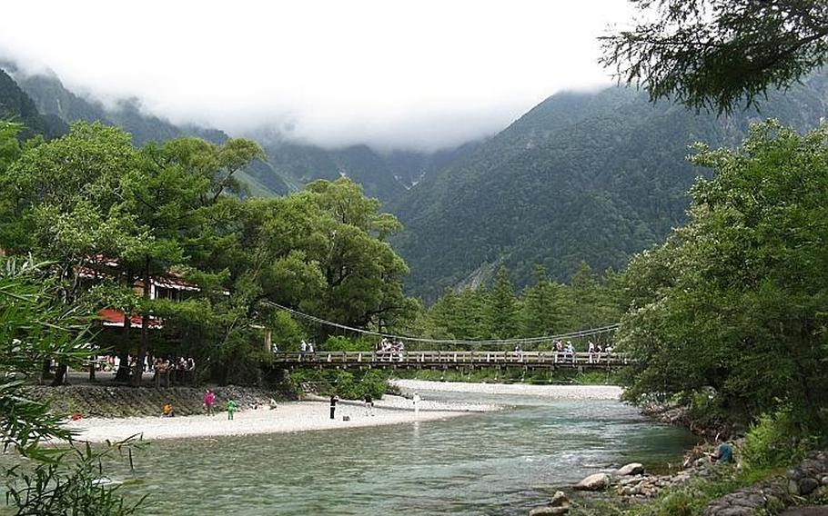 Visitors walk along the Kappabashi bridge in Kamikochi. Fortunately for those looking for a little time away from the crowds, most tourists don't venture much beyond the bridge.