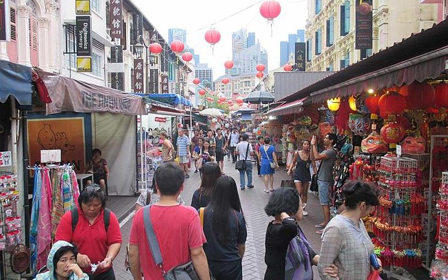Singapore's Chinatown caters to visitors with various themed shops and restaurants.