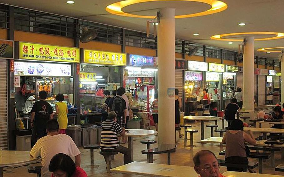 The Tiong Bahru hawker center is one of many markets in Singapore where you can buy an inexpensive, cooked-to-order meal from various vending stalls.