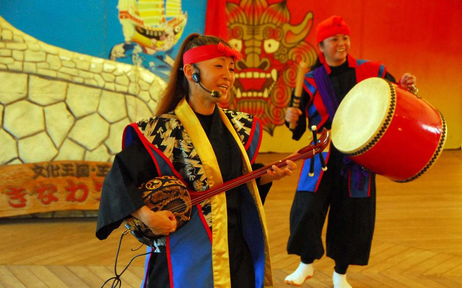 Visitors to Okinawa World can buy tickets to an Okinawan eisa dance show.
