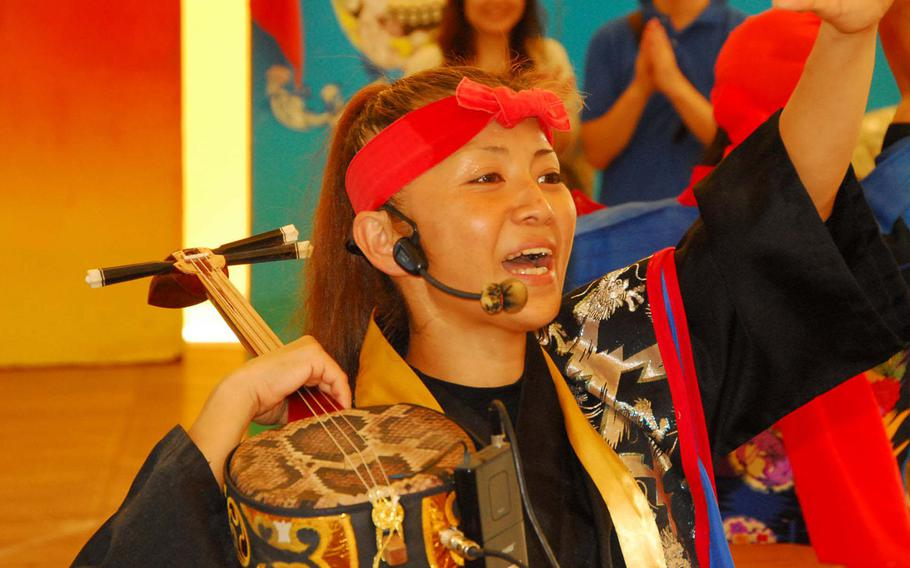 The island's traditional eisa dancing is part of the Okinawa World experience.
