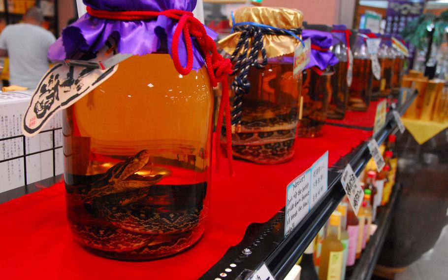 Habu sake, a local delicacy infused with the island's poisonous snake, is distilled at the park.