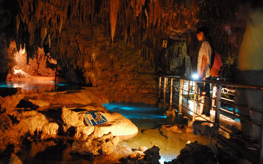 A cave chamber with pools of water.