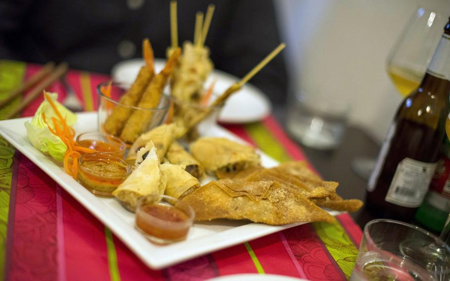 """The appetizer plate at thaicafe in downtown Naples. The spring rolls and breaded shrimp were excellent, the satay a bit dry and the """"croccantini"""" sort of dull.  Steven Beardsley/Stars and Stripes"""