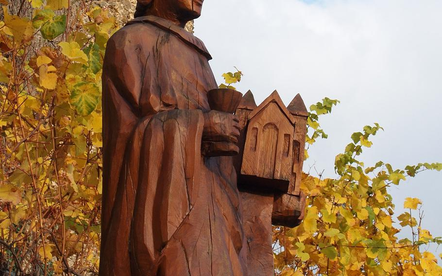 Saint Goar, the patron saint of innkeepers, potters and vine growers, stands watch over colorful vineyards at the foot of Burg Rheinfels high above the village that's named in honor of him in Germany.