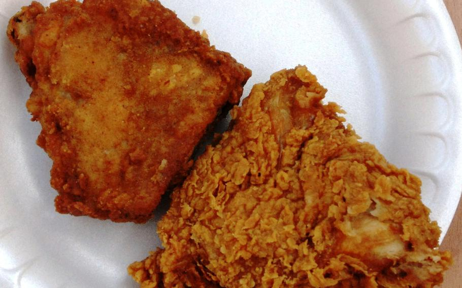 Two pieces of fried chicken --- regular recipe on the left, spicy on the right --- from Nick's Southern Fried Chicken.